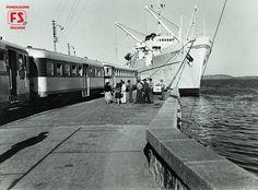 Treno Espresso Freccia Sarda per Cagliari presso la stazione marittima Isola Bianca di Olbia-Tempio (1955)