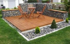 small gabion retaining wall behind patio http:www.gabion1.co.uk