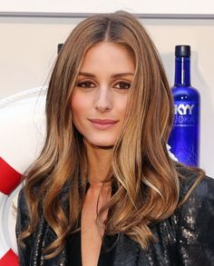 Olivia Palermo fights frizz flawlessly at a humid opening party for Governors Ball.