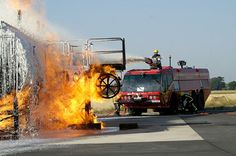 Airport rescue tender fighting fire