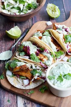 Blackened Fish Tacos with Avocado-Cilantro Sauce. These were some of the BEST tacos I've ever had! This recipe uses tilapia, but you can also try it with salmon, catfish, or whatever your heart desires! You can't go wrong with this recipe. Fish Dishes, Seafood Dishes, Seafood Recipes, Mexican Food Recipes, Cooking Recipes, Healthy Recipes, Seafood Pizza, Chef Recipes, Recipes Dinner