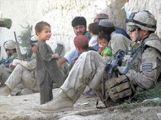 Afghanistan war with kids --- I am incredibly proud of the men and women who serve. Afghanistan War, Iraq War, War Photography, Documentary Photography, World Conflicts, First Year Teaching, Military Men, Military History, Army National Guard