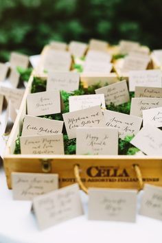 escort cards on moss - photo by Pat Furey http://ruffledblog.com/garden-wedding-at-morris-arboretum