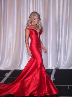 8. Miss Galaxy 2016 – Bella Normand | Probably the gown of the year, it would be impossible to ignore this style on our list for 2015. Off-the-shoulder sleeves, plunging neckline, and a dramatic mermaid gown. Bella commands the stage in this simple and regal design.  Read more: http://thepageantplanet.com/top-10-pageant-gowns-of-2015/#ixzz3xoLptaCM