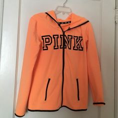 Victoria's Secret Pink Sweat jacket Excellent brand new condition worn one time, too small. Color is beautiful neon orange with black writing PINK Victoria's Secret Jackets & Coats