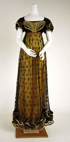 c. 1818, Dress, British. MET, 1985.27.2. Silk embroidered and embellished net over contrasting silk satin underskirt.
