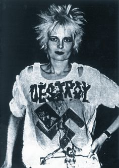 Vivienne Westwood. Punk Rock Goddess.    Example of slogan t-shirts of the time with symbols and distressing.
