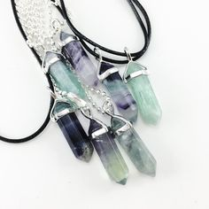 This magical green rainbow fluorite stone has a gorgeous gradient of mint and dark green, some come with hints of purple. Comes ready to wear on a black wax rop
