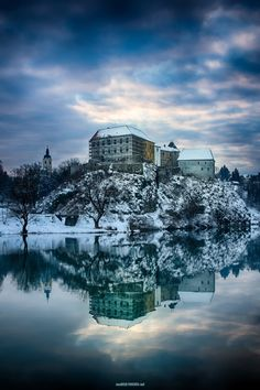 Track down Ozalj Castle in winter blue. The castle is situated on a cliff above the river Kupa and was first mentioned in 1244. It is one of the best-known...
