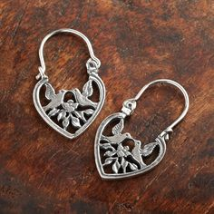 Mexican Lovebird Heart Earrings | Lovebirds alight on a rosebush and touch beaks in a midair kiss. Inspired by pre-Hispanic folklore, a Mexican artisan creates these sterling silver earrings using the lost-wax casting method. | National Geographic Store