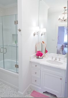 vanity, faucet, marble, chandelier, tub glass french doors, hex marble tile floor (by Munger Interiors via Cote de Texas)