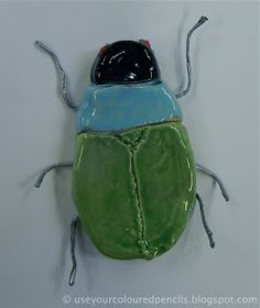 These scarab beetles were made by grade 6 students who were studying Ancient Egypt. Ancient Egyptians worshipped scarab beetles as an. Ancient Egypt Crafts, Ancient Egypt For Kids, Egyptian Crafts, Ancient Egyptian Jewelry, Egyptian Artwork, Egyptian Beetle, 3d Art Projects, Coloured Pencils, Sculptures