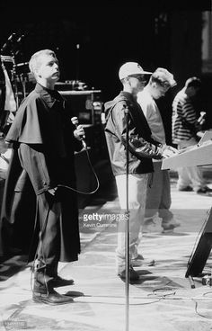 Neil Tennant and Chris Lowe, of the Pet Shop Boys, performing on stage with Bernard Sumner and Johnny Marr of Electronic, at the Dodgers Stadium, Los Angeles, USA, 4th August 1990.