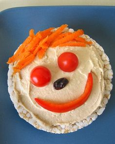 Think cucumber eyes, capsicum strip hair, snow pea nose, cherry tomato ears and a grated carrot mouth.