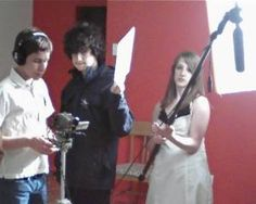 Teen Filmmakers operate camera, hold the mike boom and the slate.