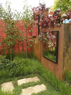 Mirrors & glass in gardens from GardenDrum. Design Peta Donaldson