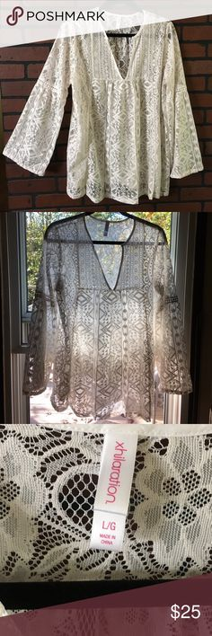 """Xhilaration top🌸 Sheer boho lace🌸 Bell sleeves🌸 popover🌸 material is body 100% polyester crochet 100% cotton🌸 ivory color🌸 shoulder to bottom measures approx 28"""" 🌸 armpit to armpit measures approx 22"""" Xhilaration Tops"""