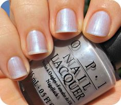 OPI--Give Me the Moon.  Depending on the lighting, this color is sometimes gray, sometimes periwinkle, sometimes lavender or pink.  It reminds me of the color of Cinderella's dress, with a slight shimmer effect.  Put simply, it is labradorite in a bottle.  Formula is smooth--the picture shows two coats.