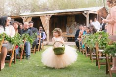 Ideas for what your flower girl and ring bearer can carry down the aisle