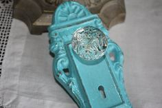 LOVE!  TURQUOISE Ornate Vintage Look Decorative Cast Iron Door Plate Hook with Glass Look Knob / Wall Hook on Etsy, $13.50