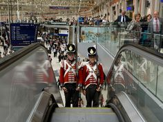 Two Battle of Waterloo re-enactors travel up the escalators at Waterloo Station after they attended the unveiling of a memorial plaque by the current Duke of Wellington, Brigadier Arthur Wellesley, in London. The bronze plaque depicts Nike the Greek goddess of Victory and has been cast by the London Mint Office to commemorate the soldiers that died on the battlefield at Waterloo in its 200th anniversary year.   Mary Turner, Getty Images