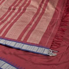 "The ""#Maroon"" #handwoven #Khadi #Silk #Sari from Taanbaan is set off by a fish motifs and temple design blue border on either side. Attractive fish motifs in beige adorn the maroon pallu."