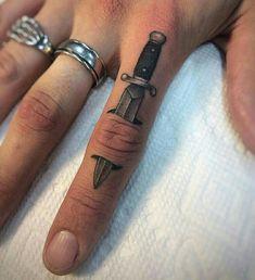 Switchblade finger tattoo