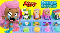 "Playing with BUBBLE GUPPIES Pop Up Pals Stacking Cups Check-up Center School Playhouse Hospital Doghouse.  Perfect for creating eye-hand coordination of toddlers and infants the Stacking-Cups comes with Mr. Grouper Molly Gil and Puppy. Safe for kids 6 months & up.  The ""Bubble Guppies Rock and Roll Stage"" plays four songs and includes one Micro-Drifters of Molly lobster microphone and drum set. Roll Molly down the ramp and on the stage to hear phrases sounds and songs from the cartoon show…"