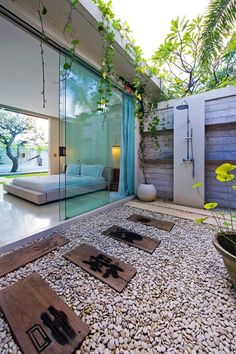 Elegant outdoor bathroom with glass roof that brings the nature inside
