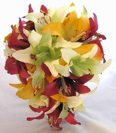 This Silk Cascade Bouquet has many peach/yellow, raspberry and white casablanca lilies.