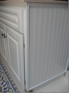 Beadboard Wallpaper! Oh, the wonderful things I could do with this. This lady updated her kitchen cupboards with it. Easy to use and much cheaper than real beadboard