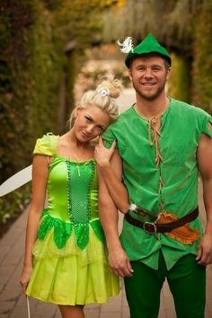 This Peter Pan and Tinkerbell costume is one of the most classic couples Halloween costume ideas! This Peter Pan and Tinkerbell costume is one of the most classic couples Halloween costume ideas! Disney Couple Costumes, Cute Couples Costumes, Cute Couple Halloween Costumes, Couples Halloween, Family Halloween, Halloween Outfits, Couple Costume Ideas, Family Costumes, Group Costumes