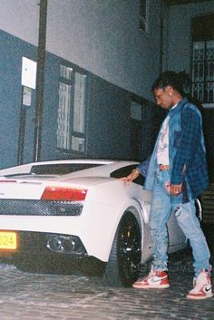 ASAP Rocky wearing Gucci Embroidered Denim Pants, Jordan Retro 1 High OG Sneakers
