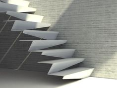 Folded steel treads powder-coated white. These are cantilevered from the side wall but could look just as good with a central steel stringer