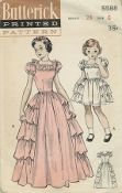 An original ca. 1951 Butterick pattern 5588.  Girls' Party Dress in two lengths.  A frilled and feminine party dress that young girls will adore.  Tiers of ruffles down the sides of the skirt give a lampshade silhouette.  Lace-edged ruffled collar, puffed sleeves.  (A)  Short Length.  (B) floor-length version.