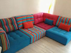 Brilliantly bright Fama Arianne sofa, via Seriously Sofas in Kingston upon Thames, UK. Fabrics by Deckchairstripes.com and Romo Linara blues and Hot Pink corner