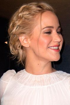 Jennifer Lawrence Weaves A Gold Necklace Through Her Messy Braid At 'The Hunger Games: Mockingjay Part 2' Premiere In Paris, 2015