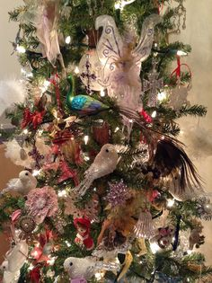 """This is my """"Woodland Fairy Christmas Tree"""".  I decorate it with fairies, crystals, pearl birds, vintage handmade flowers and old brooches, even long earrings, and, lastly Lenox China snowflakes. Love it.......ss"""
