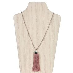 Tassels are such a beautiful, hot trend. These gorgeous pendant necklaces are a great way to celebrate this beautiful style.  - Lovely dangle necklace - Fringe style tassels - Rustic colors - PU (Man Made Leather) - Metal chain - Dimensions: 39.5 - Made in China  Catalog # 2236  In 2005, Elly Preston, set out to create something of her own. With a passion and flair for fashion and design, she began her jewelry business with the intent to offer what so many women search for…beautiful unique…