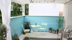 You can completely transform the look of your outdoor living space with a few sheets of corrugated and a little Behr paint.  Jen shares more photos and details of this patio intervention on her blog, Made By Girl.