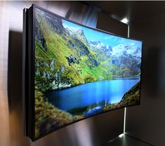 "Samsung's latest innovation is a flexible, ""bendable"" Ultra HD TV that the company unveiled at an event prior to CES2014 in Las Vegas.Samsung has made attempts in the last year to shift from flat TVs to curved ones.But the surprise is the bendable UHD TV is both a flat and a curved screen in a single advanced unit."