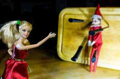 Elf on the Shelf Ideas  Elf on the Shelf helped out Barbie with her knife throwing act. He was a little nervous. #ElfOnTheShelf