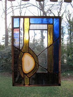 """Copper Mine - Natural Agate w/Blue and Amber Glass:  Stained Glass Panel with Agate (approx 7"""" wide x 10"""" tall) by ArtGlassInspired on Etsy"""