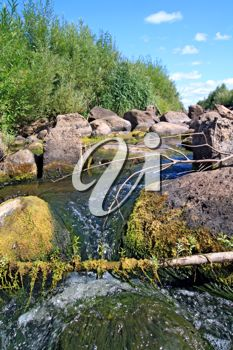 iCLIPART - Photo of a River Flowing Over Stones