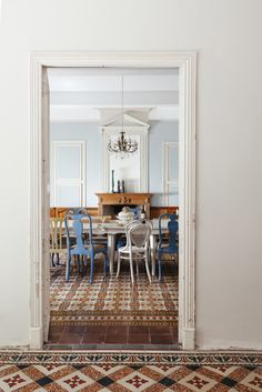 rustic and original flooring of old French chateaux looking into dining room by Nathalie Priem interiors photographer