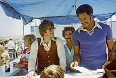 Look at Dave Winfield in 1978! Awesome shirt and afro.  (That's Pete Rose next to him in some weird little vest thing.)