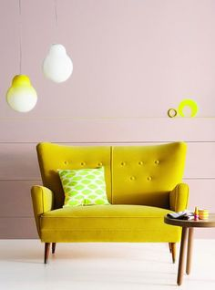 The retro yellow sofa creates a 60's inspired quirky look.