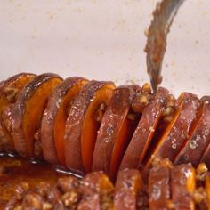 If you're a fan of sweet potatoes (I sure am!) and you like them dripping with delicious goodness, you're going to fall in love with this recipe. It's called Hasselback Maple Pecan Sweet Potatoes. Baked Sweet Potato Slices, Sweet Potato Pecan, Sweet Potato Recipes, Baked Potato, Hasselback Sweet Potatoes, Small Baking Dish, Maple Pecan, Potato Dishes, Potato Bar