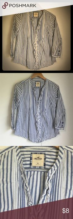 Hollister blue and white striped button down Adorable blue and white striped button down shirt from Hollister size XS. It has a cute ruffle detail on the front. Hollister Tops Button Down Shirts