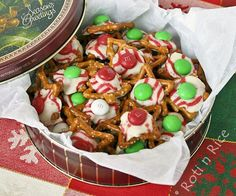 Pretzels, kisses, & m&ms!  Put a kiss on a pretzel, bake at 170 degrees for 4-6 minutes, quickly press m&m into the center